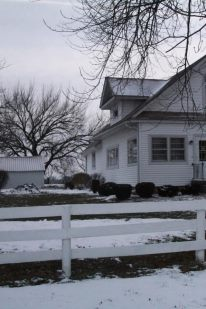 A picture of the Alexander House in the winter.